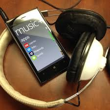 A cell phone streaming music to a set of headphones