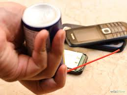 Use compressed air to dry the phone